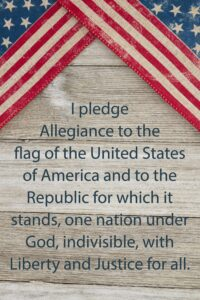 About America : weathered wood background with text of the Pledge of Allegiance