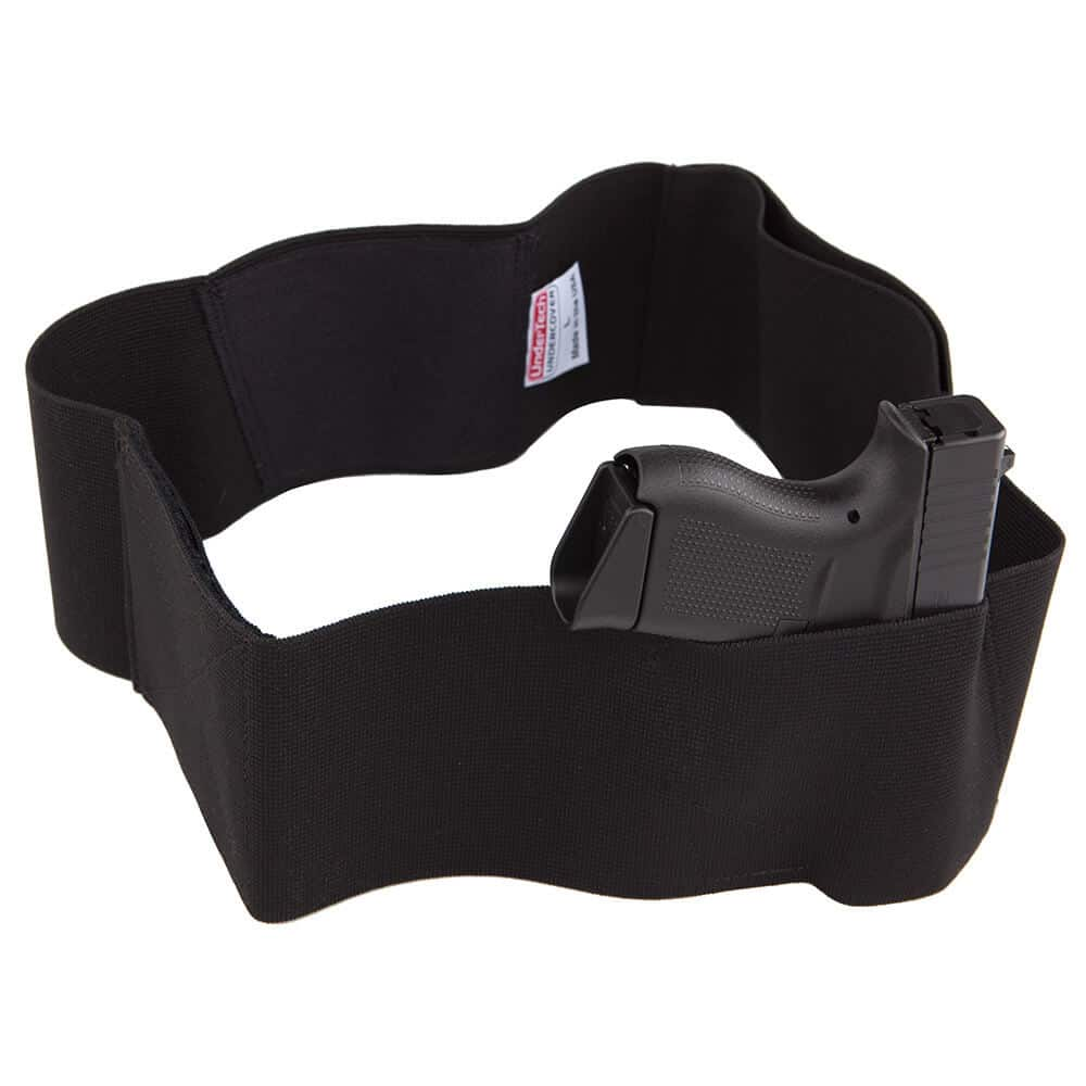 black waist holster with a gun in it
