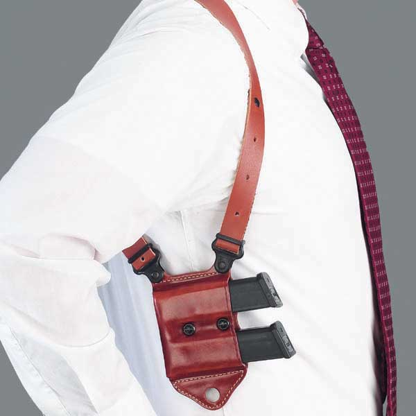 Man wearing a Galco Miami Classic II Shoulder System, one of the best shoulder holsters