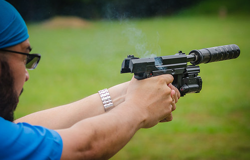 man using a gun and aiming
