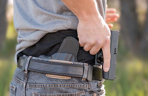 man carrying a gun