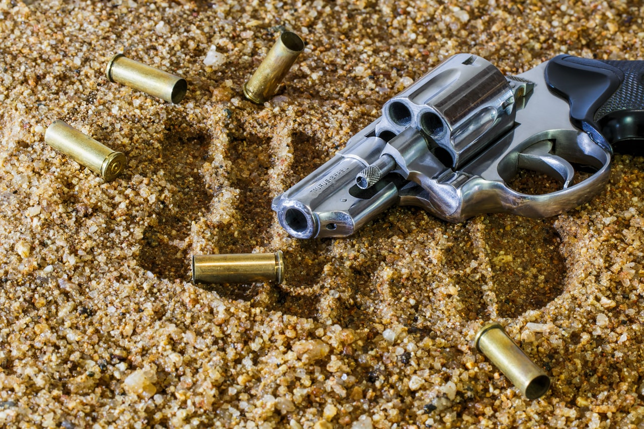 Gun with bullets on the ground