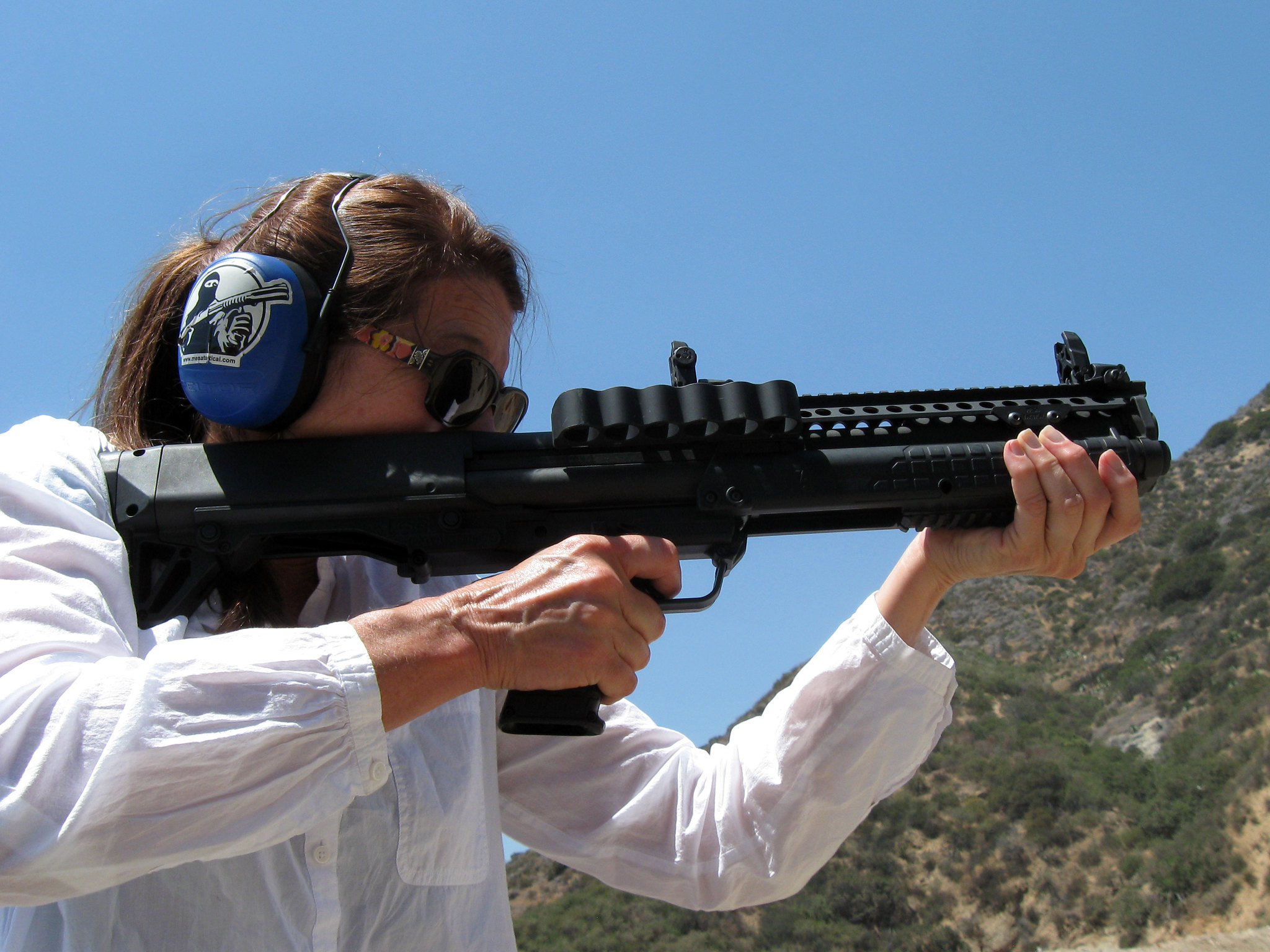 woman shooting with kel tec ksg