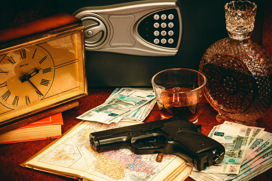 Gun in the table with wine and money